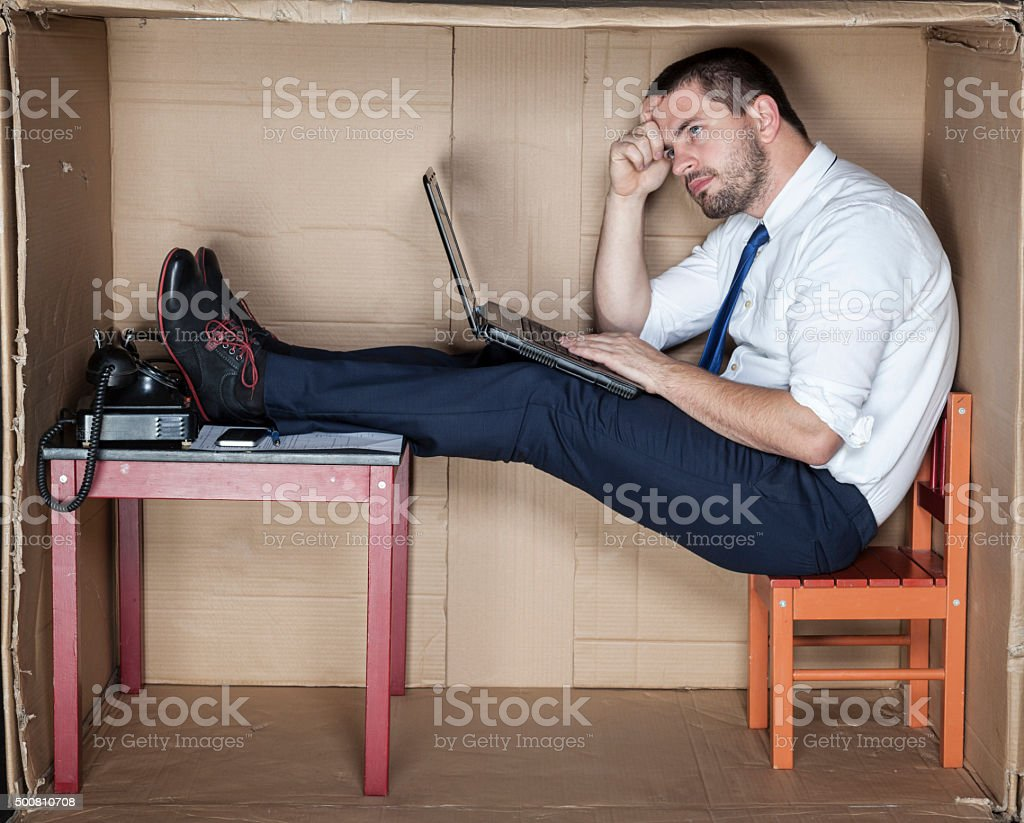 Businessman inside the box office stock photo