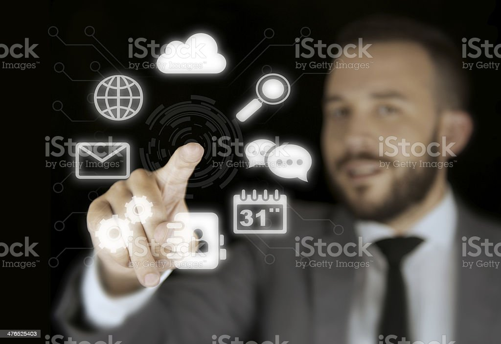 Businessman Interacting with a Virtual Interface royalty-free stock photo