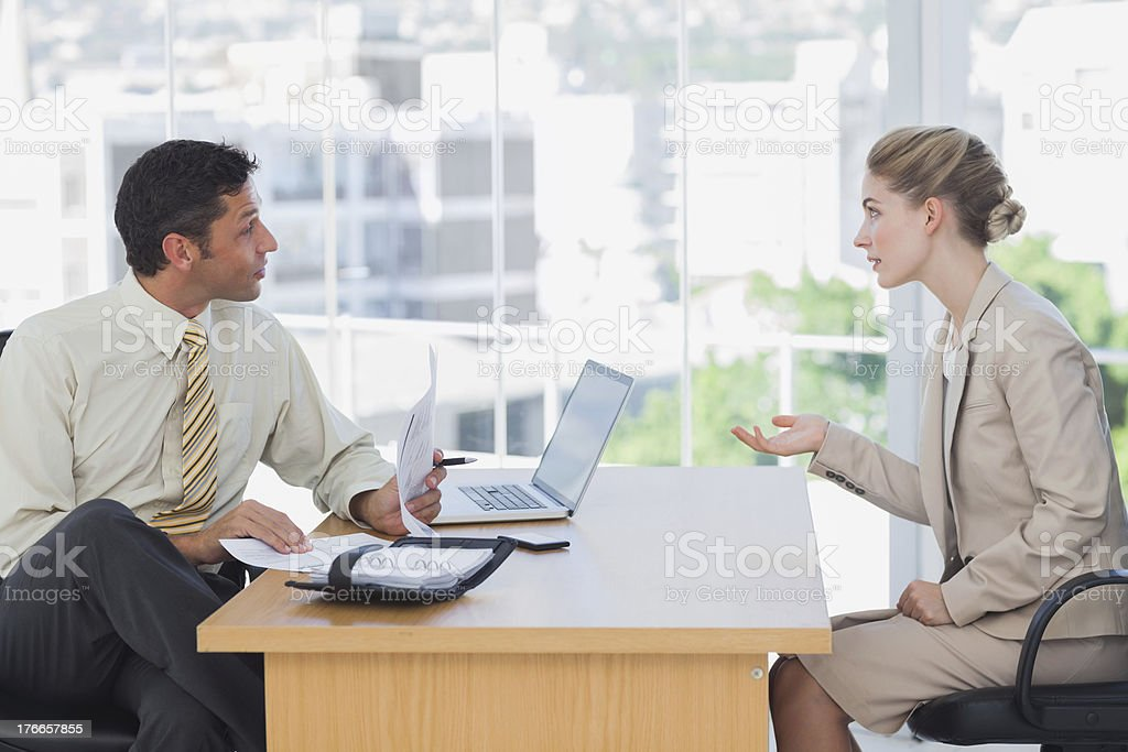 Businessman interviewing a businesswoman royalty-free stock photo