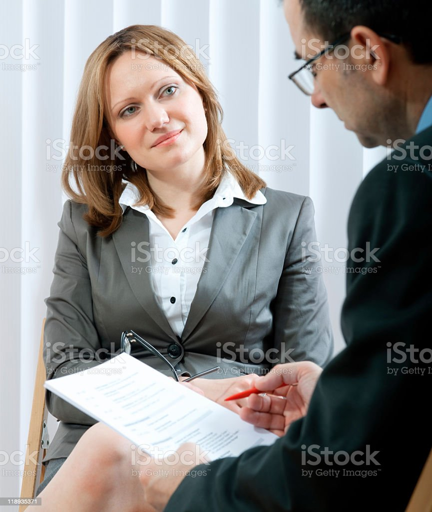 Businessman interviewing a woman for a job royalty-free stock photo