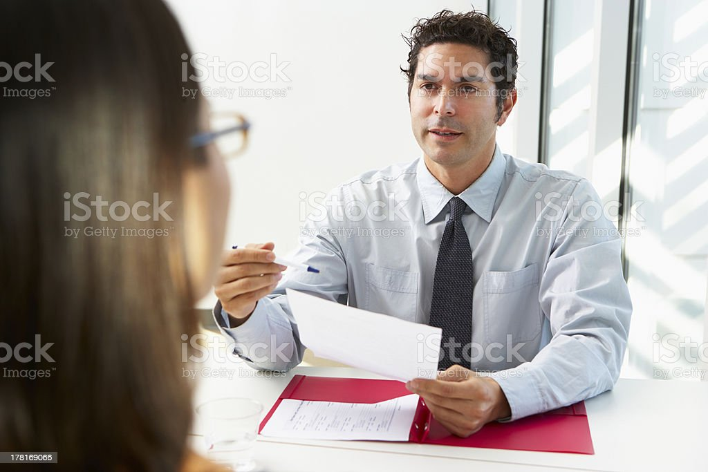 Businessman Interviewing Female Candidate For Job royalty-free stock photo
