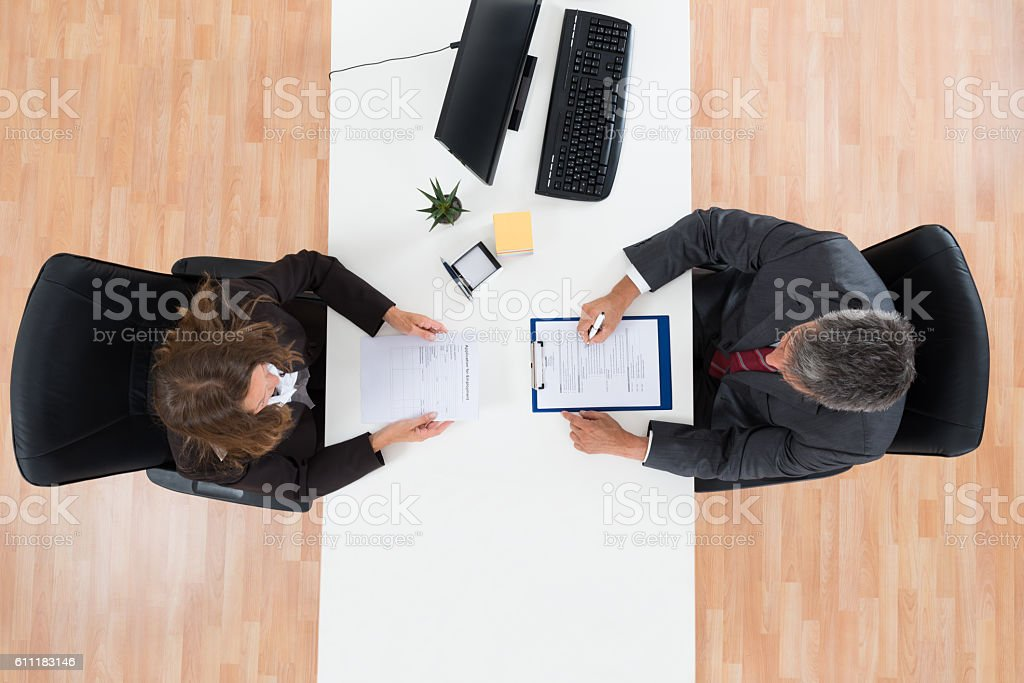 Businessman Interviewing Female Candidate stock photo