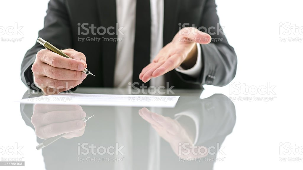 Businessman inviting you to sign a contract royalty-free stock photo