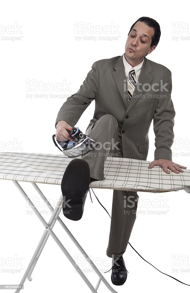 Businessman Ironing The Clothes He Is Wearing royalty-free stock photo