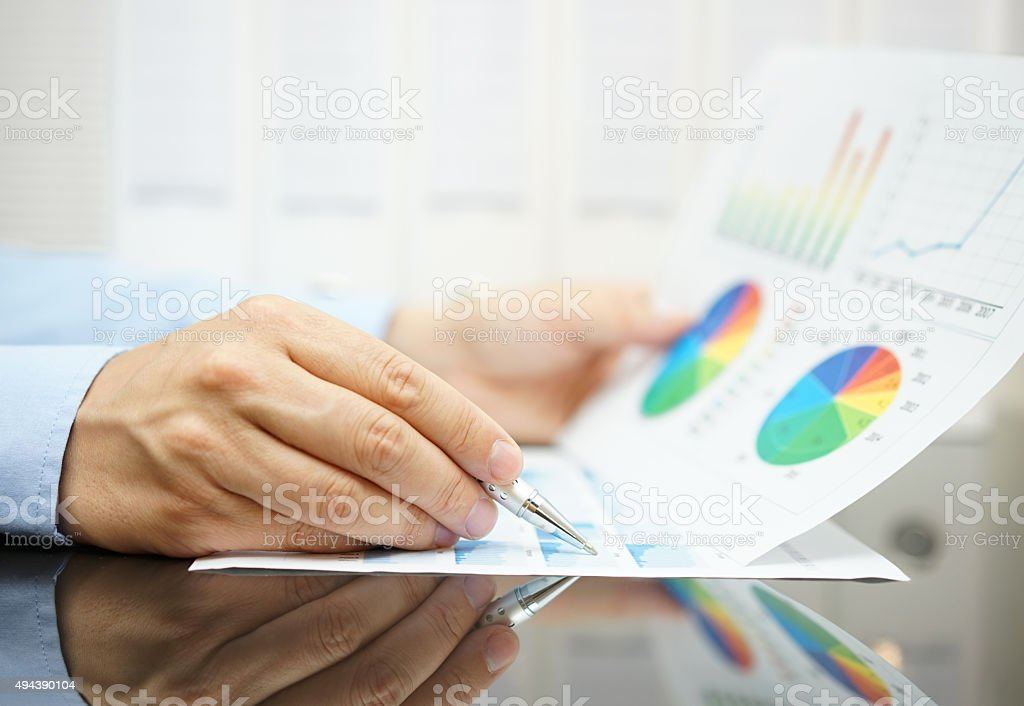 businessman is analyzing business and financial  data stock photo