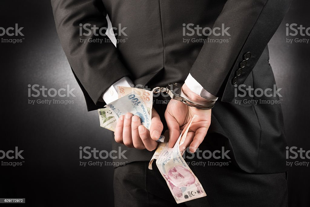 Businessman is arrested and handcuffed Turkish lira stock photo