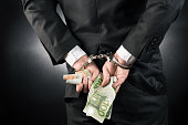 Businessman is arrested and handcuffed with Euro