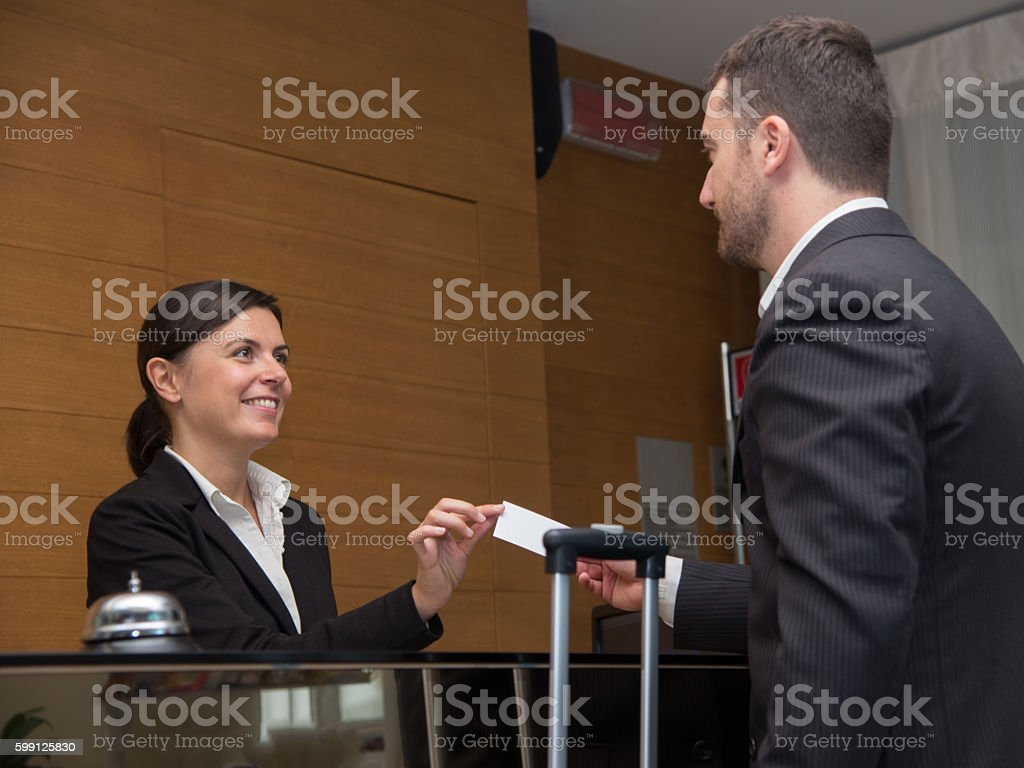 Businessman is arrived in hotel and is checking-in stock photo