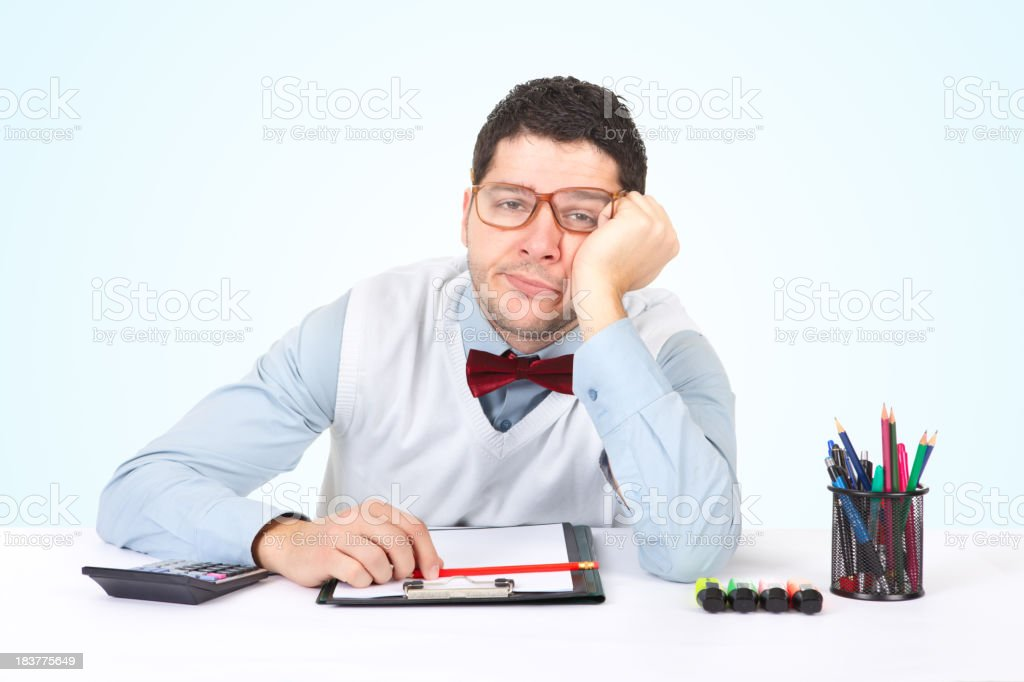Businessman is bored while sitting at his office royalty-free stock photo