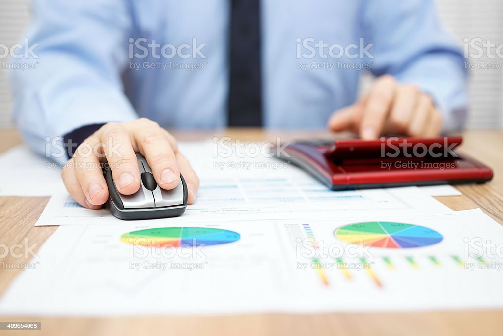 businessman is calculating data and using computer stock photo