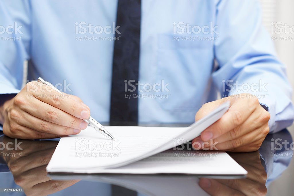 businessman is checking final price in contract stock photo