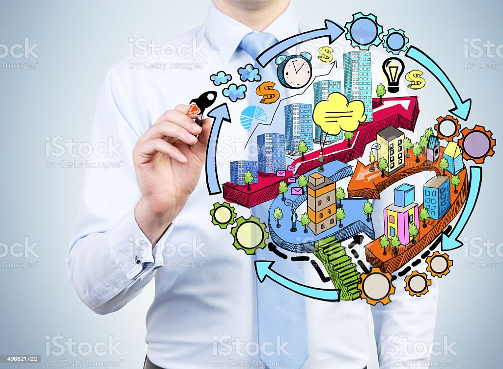 businessman is drawing a colourful city development flowchart stock photo