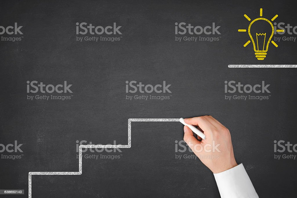 Businessman is Drawing Steps of Success stock photo