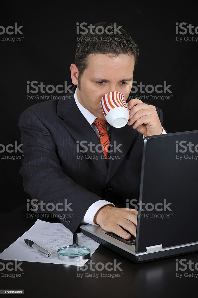 businessman is drinking coffee and working royalty-free stock photo