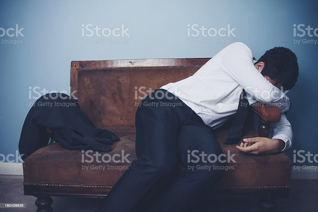 Businessman is exhausted after long day at work royalty-free stock photo