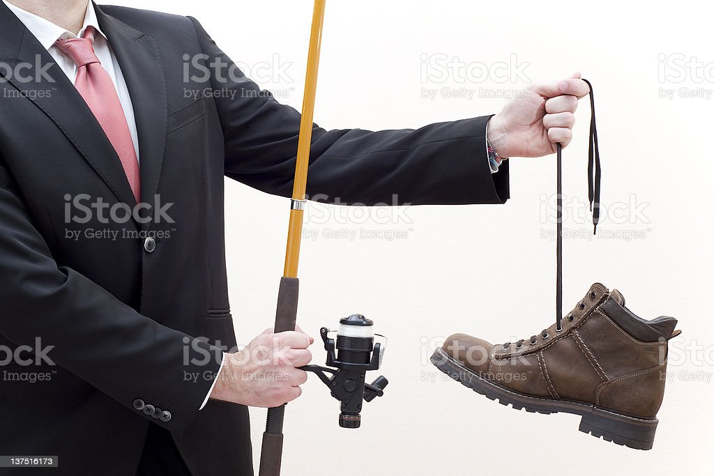 Businessman Is Fishing A Boot stock photo