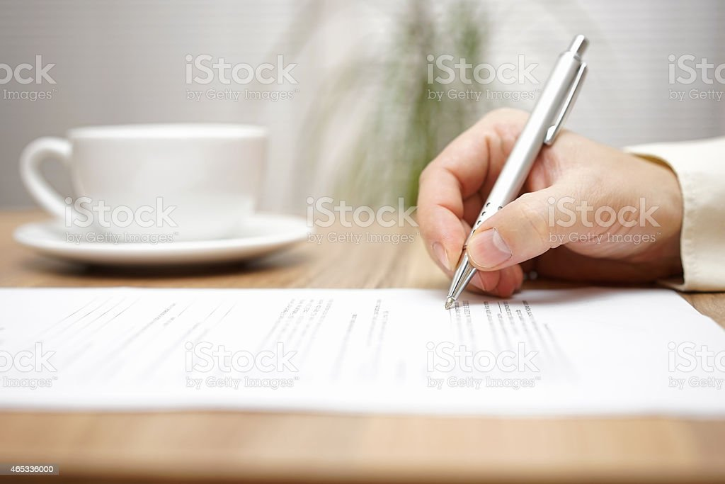 businessman is fulfilling document  late night with cup of coffee stock photo