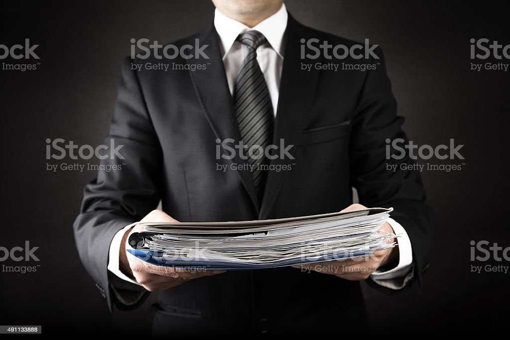 Businessman is Giving a lot of file stock photo