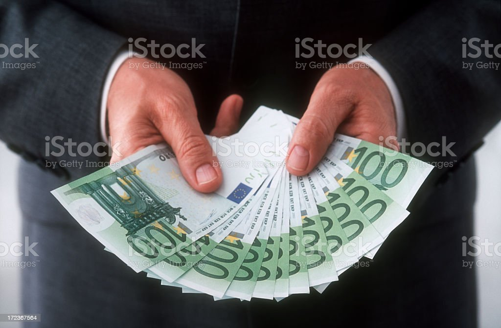 Businessman is holding 100 Euro banknotes royalty-free stock photo