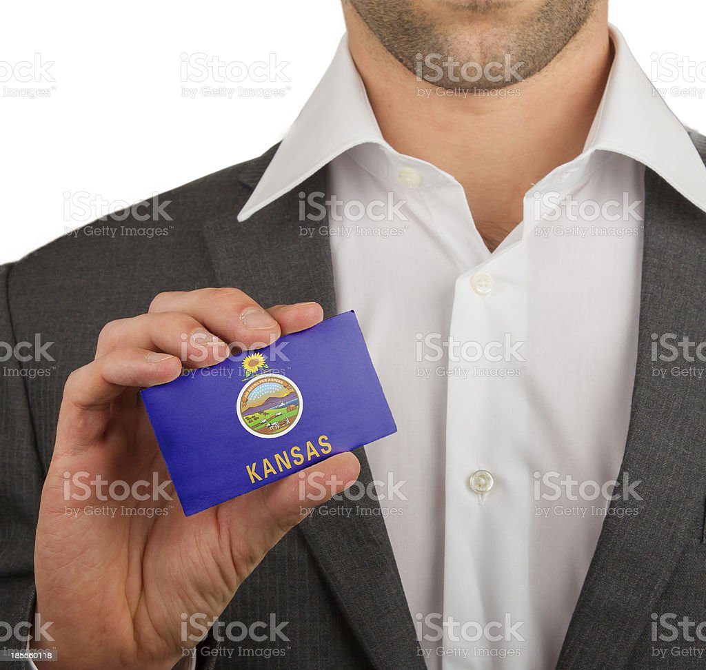 Businessman is holding a business card, Kansas stock photo