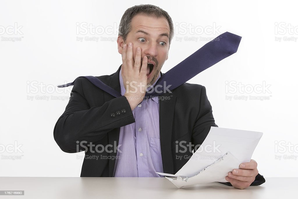 Businessman is horrified by a unbelievable bill  II royalty-free stock photo