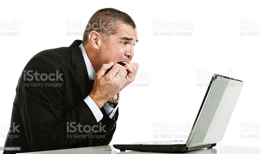 Businessman is horrified by something on laptop screen royalty-free stock photo