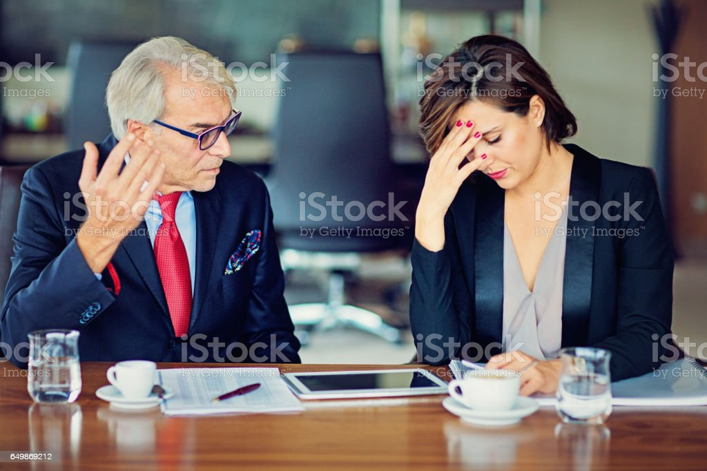 Businessman is insulting his secretary stock photo