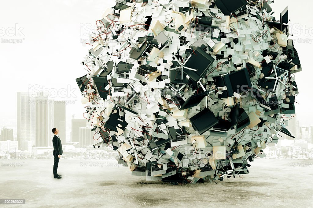 Businessman is looking at the big load of office work stock photo
