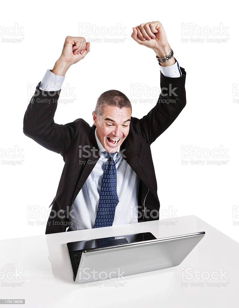 Businessman is overjoyed by something on laptop screen stock photo