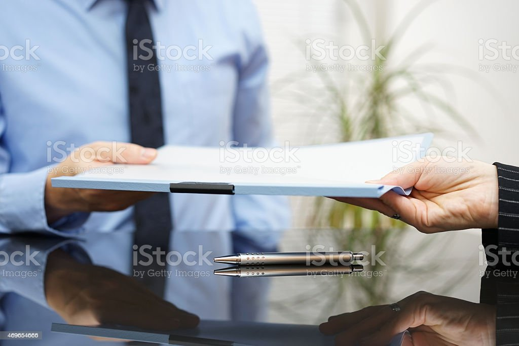 businessman is passing signed agreement to client after successful negotiation stock photo