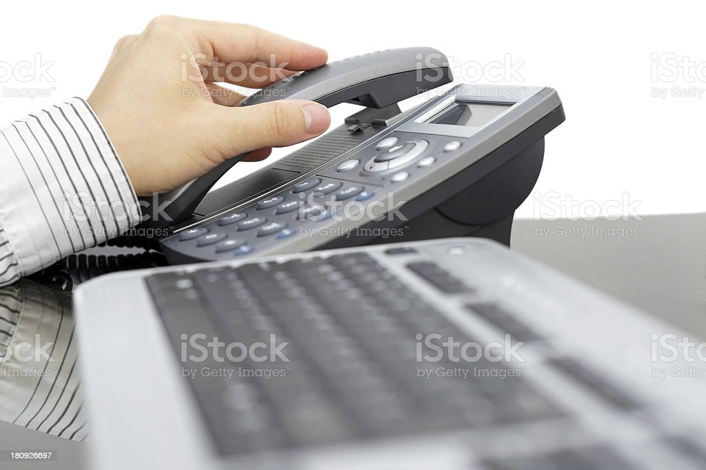 businessman is picking up the phone in office royalty-free stock photo