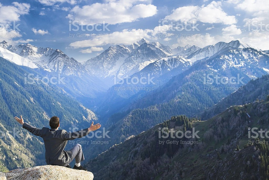 Businessman is pleased with the achieved successes stock photo