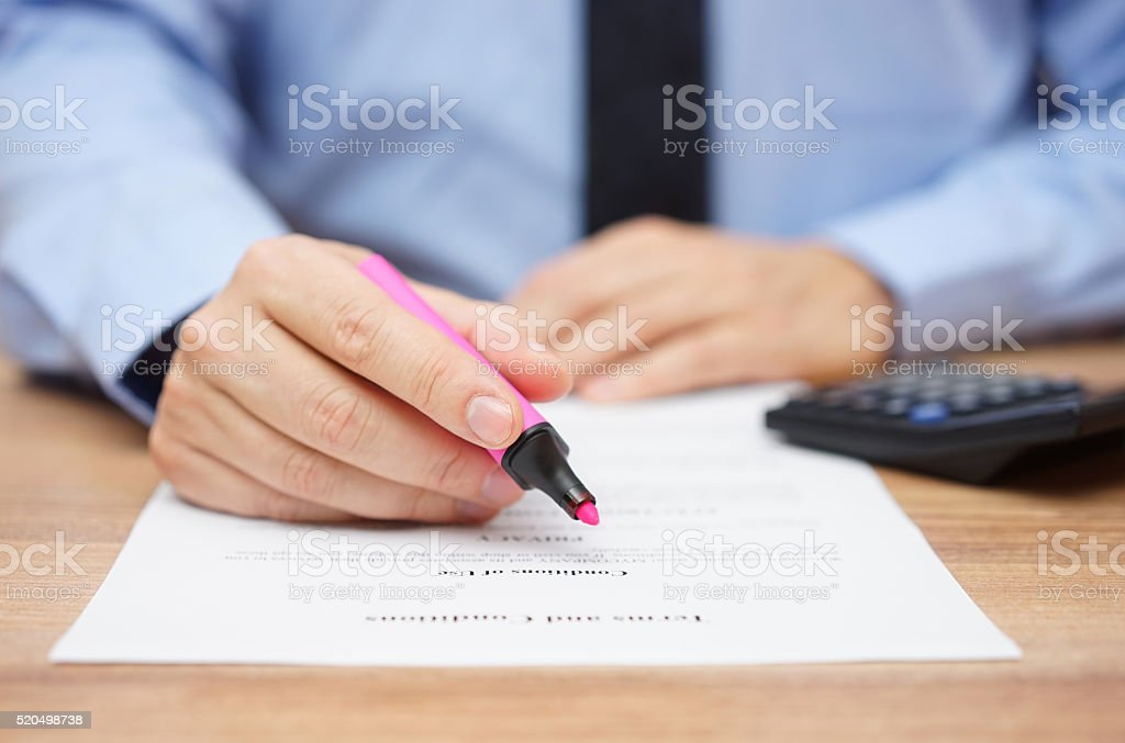 businessman is preparing to examine legal document and highlight information stock photo