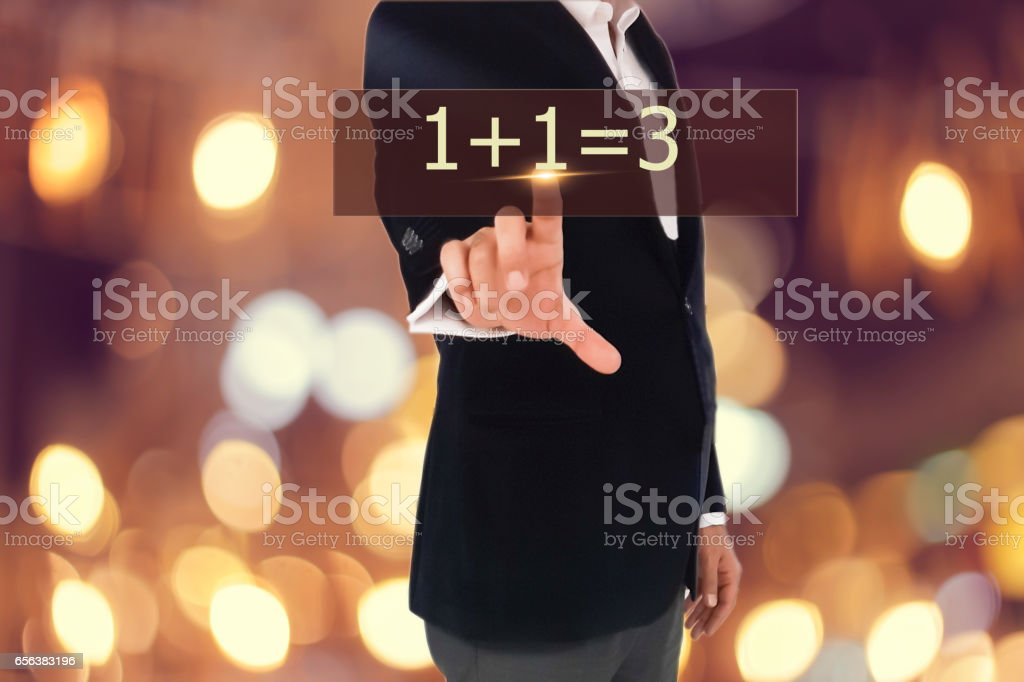 Businessman is pressing button on touch screen interface and selecting 1+1=3 stock photo