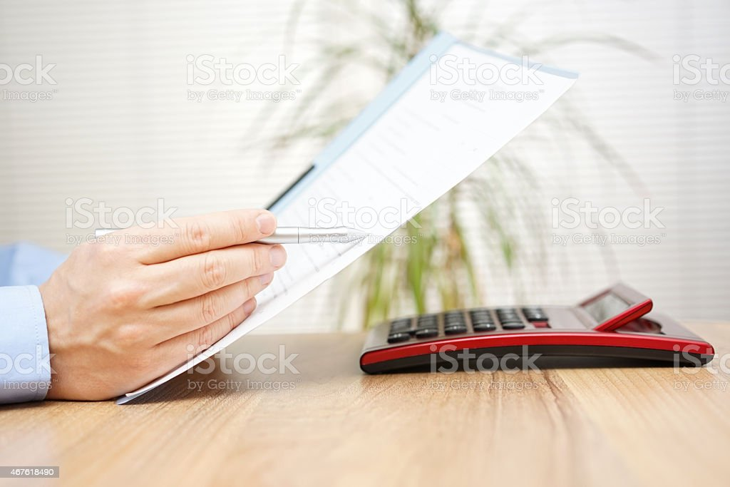 businessman is reading and checking contract stock photo