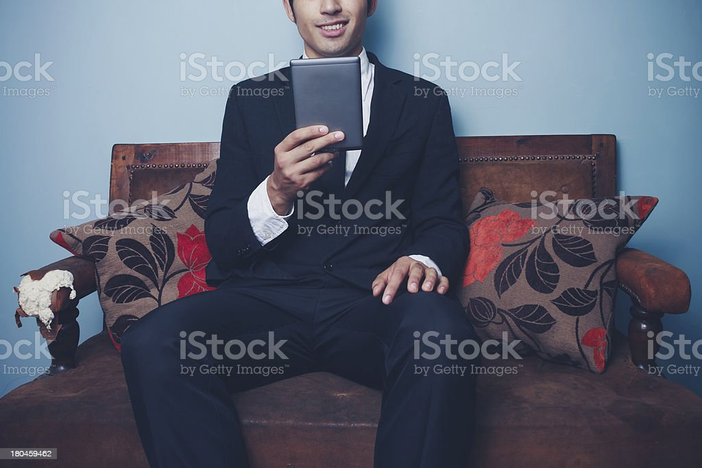 businessman is reading financial report on tablet royalty-free stock photo