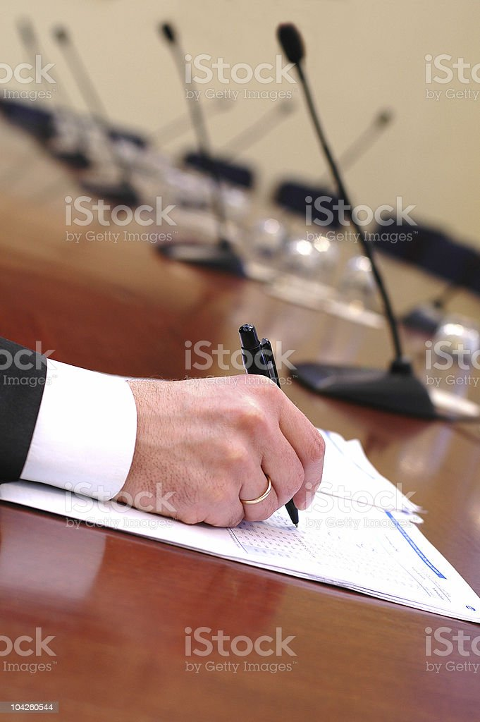 businessman is signing a contract royalty-free stock photo