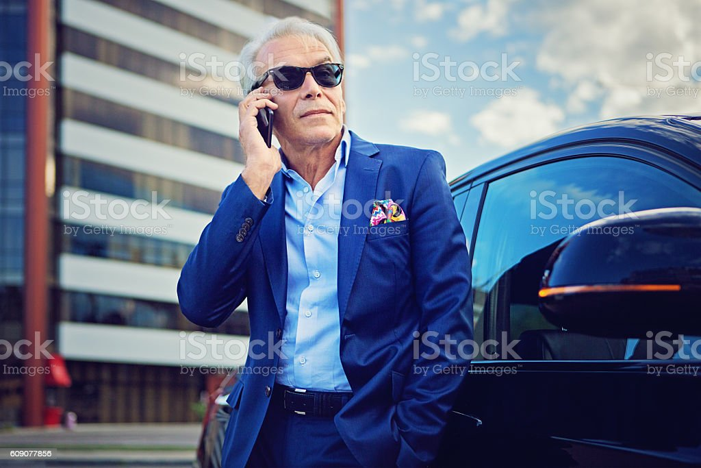 Businessman is talking using his mobile phone stock photo