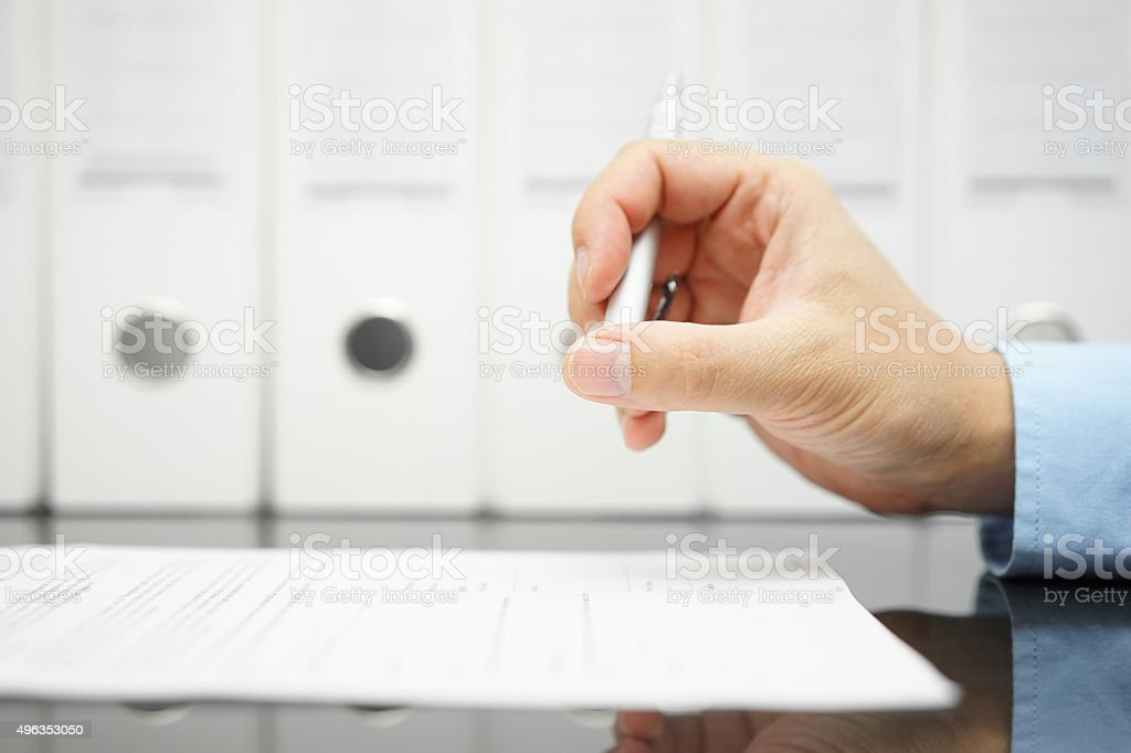 businessman is thinking about articles on contract before signing stock photo