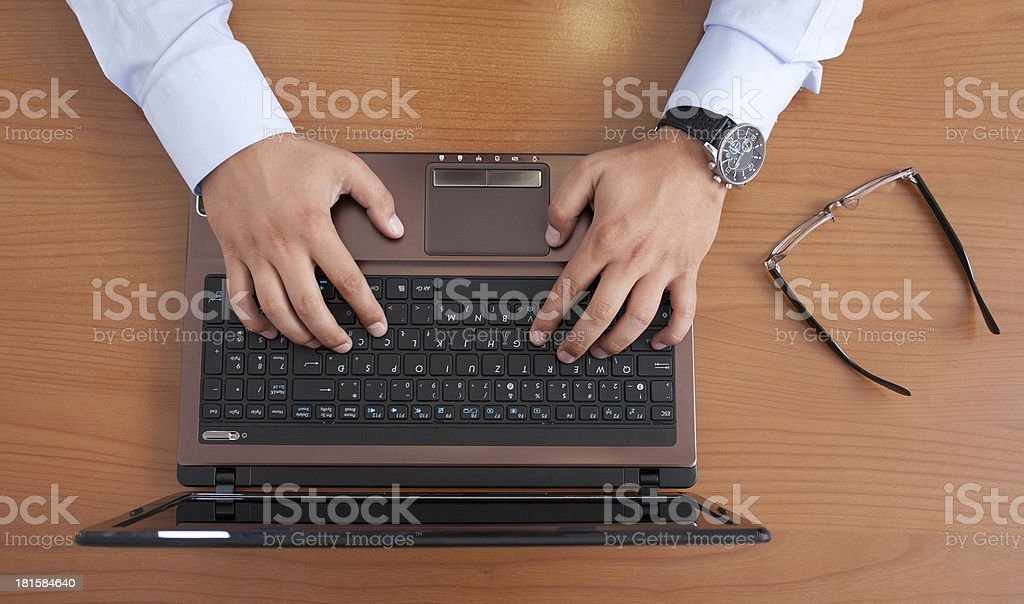 Businessman is typing on laptop royalty-free stock photo