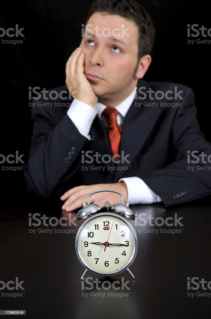 businessman is wasting time royalty-free stock photo