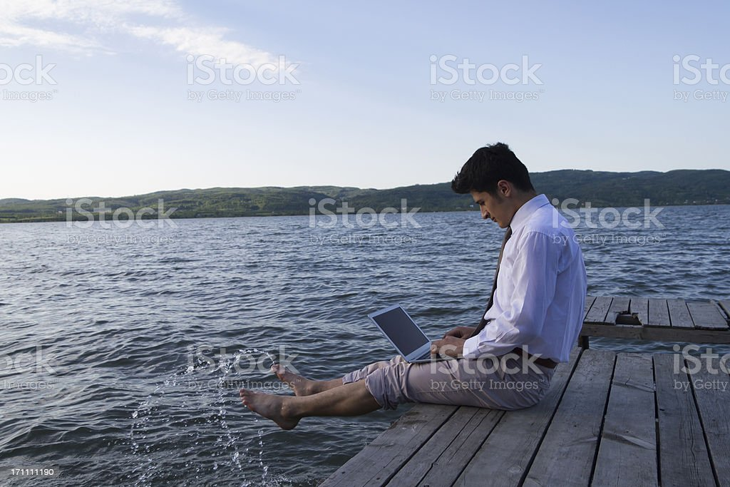 Businessman is working and relaxing in the nature. royalty-free stock photo