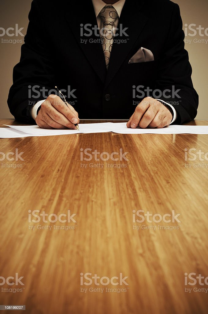 Businessman is writing a document royalty-free stock photo