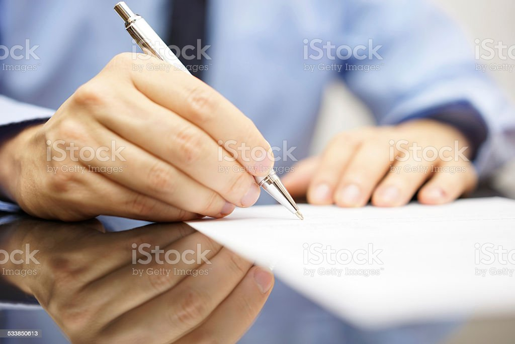 businessman is writing a letter or signing a agreement stock photo
