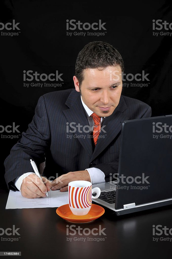 businessman is writing notes royalty-free stock photo