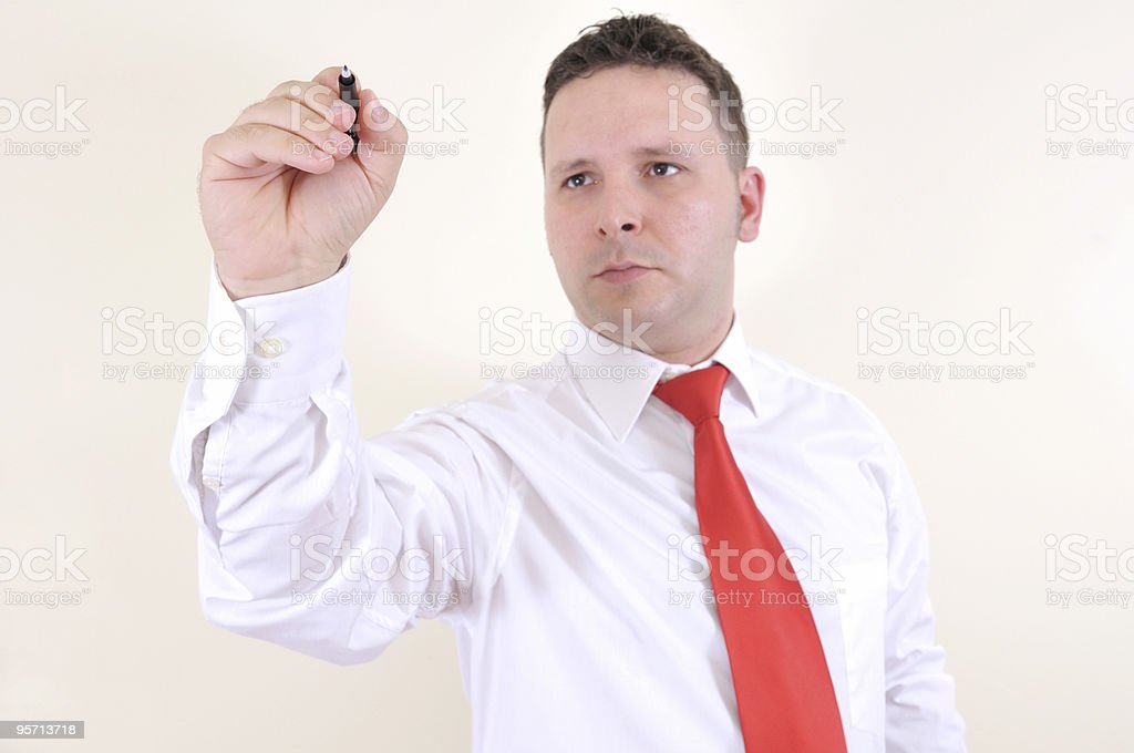 businessman is writing on a virtual whiteboard royalty-free stock photo