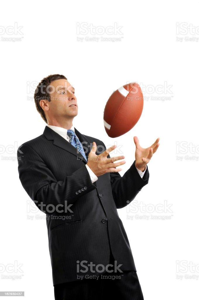 Businessman Isolated on White Background Catching Football royalty-free stock photo