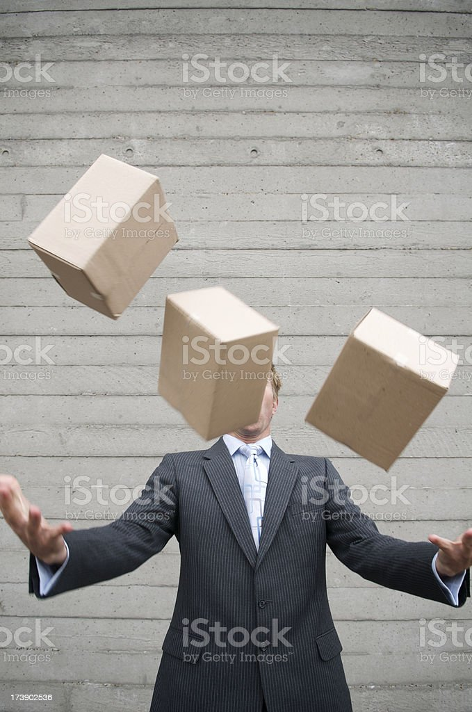 Businessman Juggles Brown Boxes stock photo