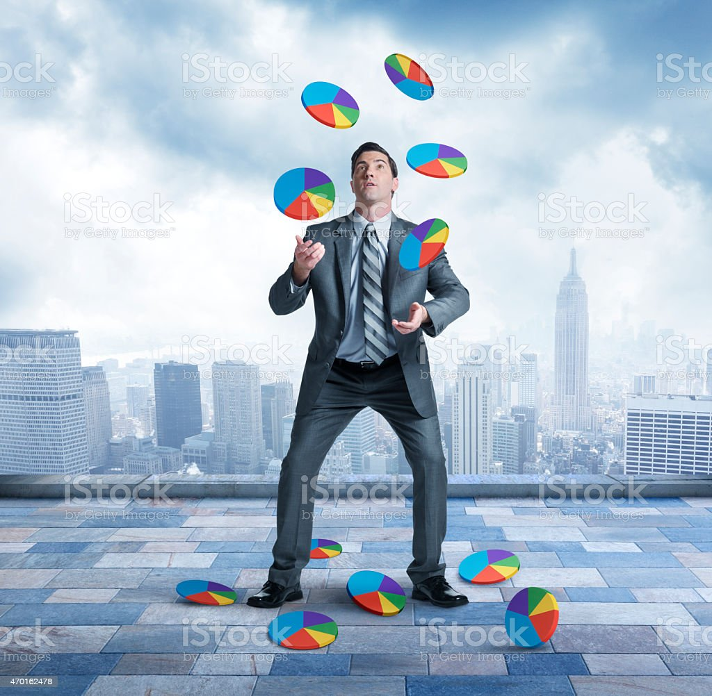Businessman juggling and losing control stock photo