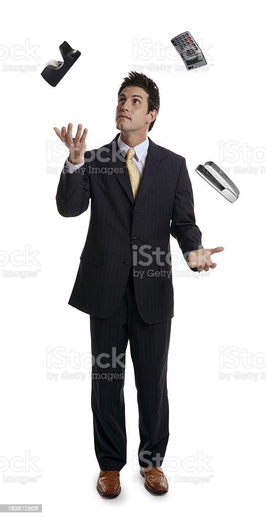 Businessman Juggling Office Supplies stock photo